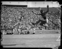 Jesse Owens pictured in a broad jump midair, Los Angeles, 1930s