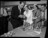 Ernie Smith and wife Ruth examine their stolen silverware at Wilshire Jail, Los Angeles, 1935