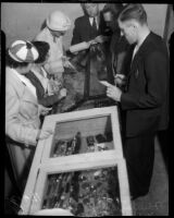 Couples examine stolen jewelry at Wilshire Jail, Los Angeles, 1935