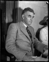 Board of Education member George W. McDill sitting in a room, Los Angeles, 1935