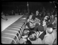 Wrestler lands in crowd during Dusek-López wrestling match, Los Angeles, 1935