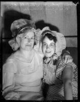Mrs. John Witty and Margaret Herroder don bonnets for charity, Los Angeles, 1935