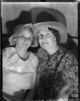 Mrs. L.E. Oates and Mrs. Charles Laraway don sun bonnets for a charity event, Los Angeles, 1935