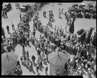 Crowds gather to watch Bob Swanson and Rex Mays race at the Legion Ascot Speedway, Los Angeles, 1935
