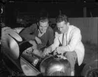 Race car drivers Rex Mays and Bob Swanson pose at the Legion Ascot speedway, Los Angeles, 1935