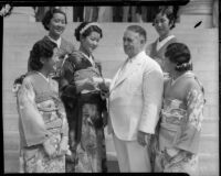 Miss Lil Tokio Alice Watanabe extends an invitation to Mayor Frank L. Shaw for the annual Nsei festival, Los Angeles, 1935