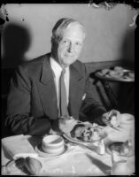 Senator Culbert L. Olson dines at a convention for the California Federation of Democratic Women's Clubs