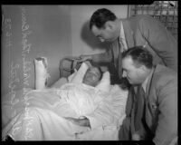 Detectives Aldo Corsini and Thad Brown visit shooting victim Joseph E. Walsh, Los Angeles, 1935