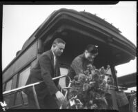 Eleanor Roosevelt receives welcome bouquet upon arrival at Central Station, Los Angeles, October 1, 1935