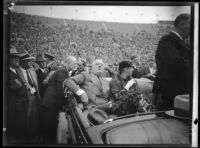 President Franklin D. Roosevelt, accompanied by Eleanor Roosevelt, about to address the crowd at Los Angeles Memorial Coliseum from car, October 1, 1935