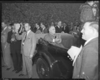 President Franklin D. Roosevelt with hat over heart in back of open air car, Los Angeles, October 1, 1935