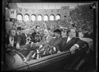 President Franklin D. Roosevelt speaks to reporters from car with First Lady Eleanor Roosevelt and Mayor Frank Shaw at the Los Angeles Memorial Coliseum, October 1, 1935