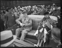 President Franklin D. Roosevelt and Eleanor Roosevelt sit in open air car at start of motorcade tour of Los Angles, October 1, 1935