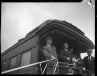 President Franklin D. Roosevelt and Eleanor Roosevelt greet the crowd from his train at Central Station, Los Angeles, October 1, 1935