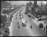 Crowds line the road to greet President Franklin D. Roosevelt's motorcade, October 1, 1935
