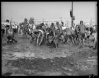 Los Angeles Junior College students in yearly mud battle, February 1936