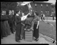 Female student crowned during paddle day at Los Angeles Junior College, February 1936