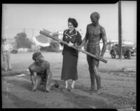 Play beheading at Los Angeles Junior College students' yearly mud battle, February 1936