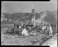 People examine the remains of a house destroyed by forest fire, Altadena, California, October 1935