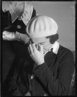 Policewoman Jean Peirce in tears, Los Angeles, circa December 1935