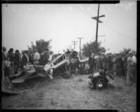 Crowd around wreckage from George (Tony) Schwamm plane crash, Los Angeles, October 1935