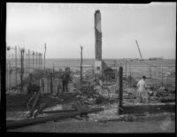 Remnants of destroyed home on Malibu beach after a fire, circa October 1935