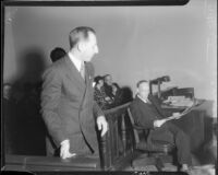 Los Angeles County District Attorney Buron Fitts arrives in courtroom, circa 1935