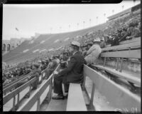 Crowd at the Coliseum during a football game between the UCLA Bruins and Loyola Marymount Lions, Los Angeles, circa 1935