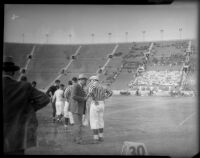 Coach and referee during college football game between the UCLA Bruins and Loyola Marymount Lions at the Coliseum, Los Angeles, circa 1935