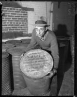 Unknown man with unknown container in WPA warehouse , circa 1936