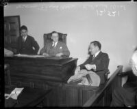 Coroner Frank Nance listens to testimony from Roland West at the grand jury hearings into death of actress Thelma Todd, December 18, 1935