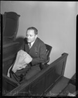 Director Roland West testifying at grand jury investigation into death of actress Thelma Todd, circa 1935