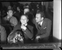 Roland West and Harvey Priester in audience for grand jury hearings into death of actress Thelma Todd, circa 1935