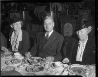 William Gibbs McAdoo at dinner event with two unknown women