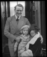 English actor Herbert Rawlinson disembarks from train with wife and young daughter Sally Ann, late 1920s.
