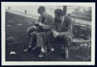 Aldous Huxley seated outside with son Matthew Huxley [descriptive]