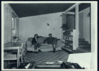 Aldous and Maria Huxley seated on a couch