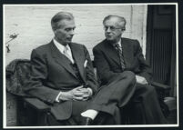 Aldous and Julian Huxley seated, talking (1) [descriptive]