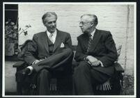 Aldous and Julian Huxley seated, talking (2) [descriptive]