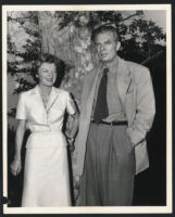 Aldous and Laura Huxley standing in front of a tree, Los Angeles, 1956 [descriptive]