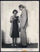 Aldous Huxley with Laura Huxley holding a book [descriptive]