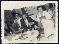 Aldous and Laura Huxley seated with unidentified women [descriptive]