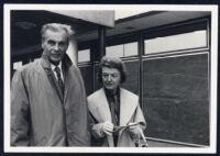 Aldous and Laura Huxley walking, wearing coats [descriptive]