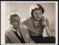 Aldous and Laura Huxley, seated looking off to right [descriptive]