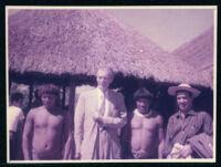 Aldous Huxley in village with three unidentified men [descriptive]