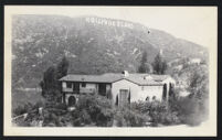 Huxley house, with Hollywoodland sign in background [descriptive]
