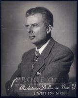 Aldous Huxley portrait, profile with arms crossed [descriptive]