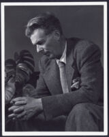 Aldous Huxley seated, looking down, hands clasped, circa 1948 [descriptive]
