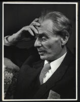 Aldous Huxley portrait profile, hand to forehead
