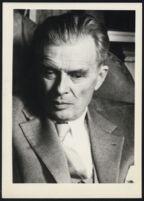 Aldous Huxley close up, portrait, looking down [descriptive]